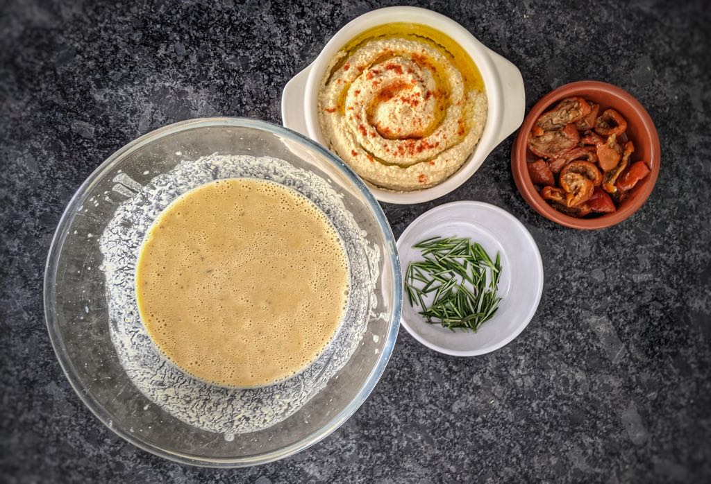 Socca Batter, Houmous and Sun-dried Tomatoes